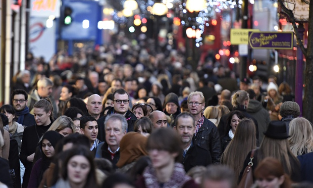 Christmas Shoppers on Oxford Street, London (Image courtesy of The Guardian).